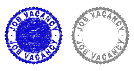 Grunge JOB VACANCY stamp seals isolated on a white background. Rosette seals with distress texture in blue and grey colors. Vector rubber stamp imitation of JOB VACANCY tag inside round rosette.