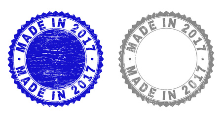 Grunge MADE IN 2017 stamp seals isolated on a white background. Rosette seals with distress texture in blue and grey colors. Vector rubber stamp imitation of MADE IN 2017 title inside round rosette. Çizim