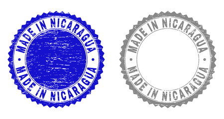 Grunge MADE IN NICARAGUA stamp seals isolated on a white background. Rosette seals with grunge texture in blue and gray colors.