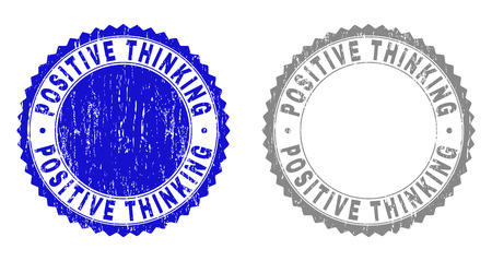 Grunge POSITIVE THINKING stamp seals isolated on a white background. Rosette seals with grunge texture in blue and grey colors.