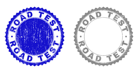 Grunge ROAD TEST stamp seals isolated on a white background. Rosette seals with grunge texture in blue and grey colors. Vector rubber stamp imitation of ROAD TEST tag inside round rosette.