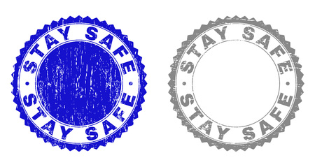 Grunge STAY SAFE stamp seals isolated on a white background. Rosette seals with grunge texture in blue and gray colors. Vector rubber stamp imprint of STAY SAFE tag inside round rosette. Illustration