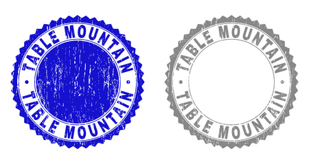Grunge TABLE MOUNTAIN stamp seals isolated on a white background. Rosette seals with grunge texture in blue and gray colors. Vector rubber stamp imprint of TABLE MOUNTAIN tag inside round rosette.