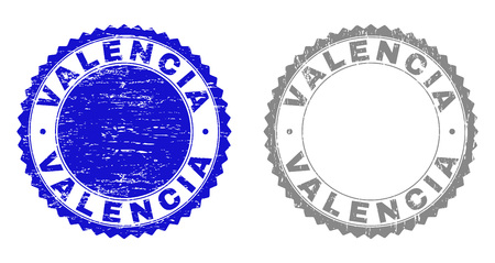 Grunge VALENCIA stamp seals isolated on a white background. Rosette seals with grunge texture in blue and grey colors. Vector rubber stamp imitation of VALENCIA text inside round rosette.  イラスト・ベクター素材