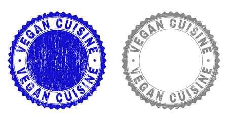 Grunge VEGAN CUISINE stamp seals isolated on a white background. Rosette seals with distress texture in blue and grey colors. Vector rubber stamp imprint of VEGAN CUISINE text inside round rosette.
