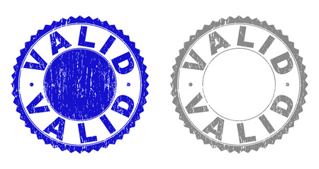 Grunge VALID stamp seals isolated on a white background. Rosette seals with grunge texture in blue and grey colors. Vector rubber stamp imprint of VALID label inside round rosette.