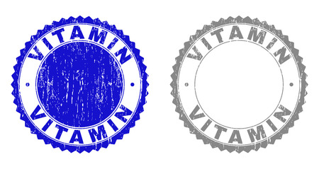 Grunge VITAMIN stamp seals isolated on a white background. Rosette seals with grunge texture in blue and gray colors. Vector rubber stamp imprint of VITAMIN tag inside round rosette. Illustration