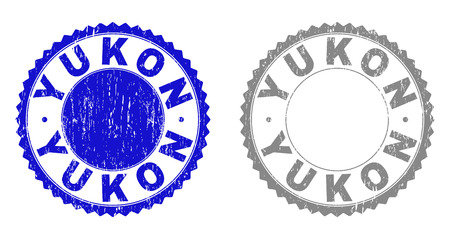 Grunge YUKON stamp seals isolated on a white background. Rosette seals with grunge texture in blue and gray colors. Vector rubber stamp imitation of YUKON tag inside round rosette.