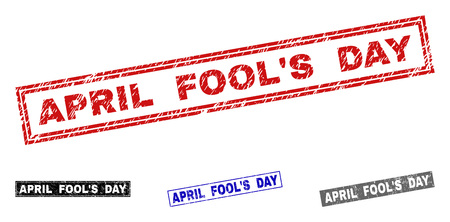 Grunge APRIL FOOL'S DAY rectangle stamp seals isolated on a white background. Rectangular seals with grunge texture in red, blue, black and gray colors. Banque d'images - 124729369