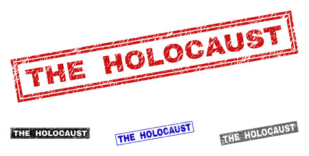 Grunge THE HOLOCAUST rectangle stamp seals isolated on a white background. Rectangular seals with grunge texture in red, blue, black and gray colors.