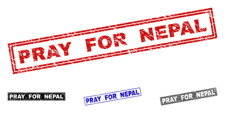 Grunge PRAY FOR NEPAL rectangle stamp seals isolated on a white background. Rectangular seals with grunge texture in red, blue, black and gray colors.