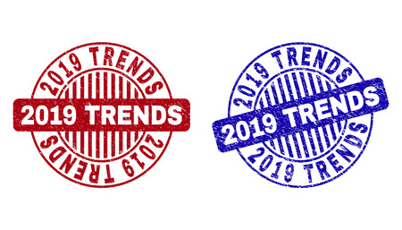 Grunge 2019 TRENDS round stamp seals isolated on a white background. Round seals with grunge texture in red and blue colors. Vector rubber watermark of 2019 TRENDS tag inside circle form with stripes.