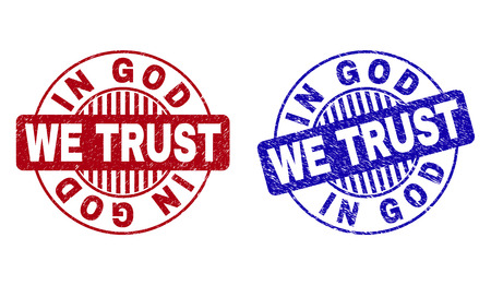 Grunge IN GOD WE TRUST round stamp seals isolated on a white background. Round seals with grunge texture in red and blue colors.