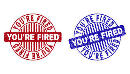 Grunge YOURE FIRED round stamp seals isolated on a white background. Round seals with grunge texture in red and blue colors.