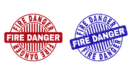 Grunge FIRE DANGER round stamp seals isolated on a white background. Round seals with grunge texture in red and blue colors.
