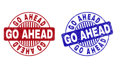 Grunge GO AHEAD round stamp seals isolated on a white background. Round seals with grunge texture in red and blue colors. Vector rubber imprint of GO AHEAD label inside circle form with stripes.
