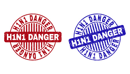 Grunge H1N1 DANGER round stamp seals isolated on a white background. Round seals with grunge texture in red and blue colors.