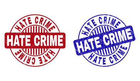 Grunge HATE CRIME round stamp seals isolated on a white background. Round seals with distress texture in red and blue colors. Vector rubber imprint of HATE CRIME tag inside circle form with stripes.