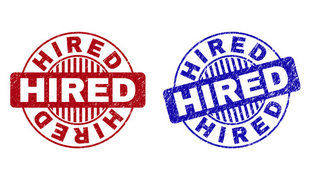 Grunge HIRED round watermarks isolated on a white background. Round seals with grunge texture in red and blue colors. Vector rubber imprint of HIRED text inside circle form with stripes.