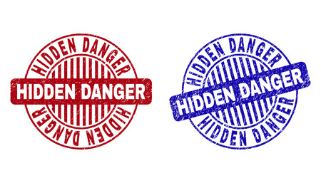 Grunge HIDDEN DANGER round stamp seals isolated on a white background. Round seals with grunge texture in red and blue colors.