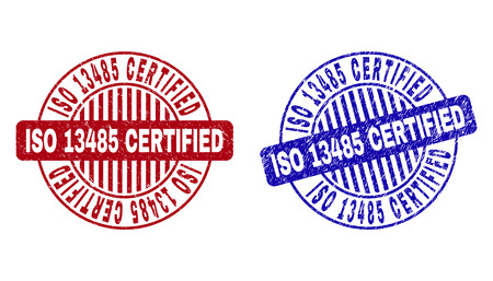 Grunge ISO 13485 CERTIFIED round stamp seals isolated on a white background. Round seals with distress texture in red and blue colors.