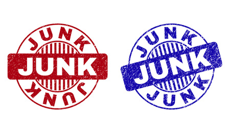 Grunge JUNK round stamp seals isolated on a white background. Round seals with grunge texture in red and blue colors. Vector rubber overlay of JUNK text inside circle form with stripes.