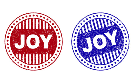 Grunge JOY round watermarks isolated on a white background. Round seals with grunge texture in red and blue colors. Vector rubber watermark of JOY caption inside circle form with stripes.