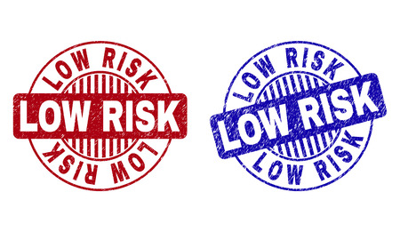 Grunge LOW RISK round stamp seals isolated on a white background. Round seals with grunge texture in red and blue colors. Vector rubber imitation of LOW RISK text inside circle form with stripes. Illustration