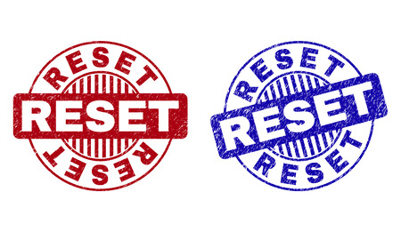 Grunge RESET round stamp seals isolated on a white background. Round seals with grunge texture in red and blue colors. Vector rubber watermark of RESET caption inside circle form with stripes.