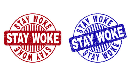 Grunge STAY WOKE round stamp seals isolated on a white background. Round seals with grunge texture in red and blue colors. Vector rubber imitation of STAY WOKE label inside circle form with stripes.