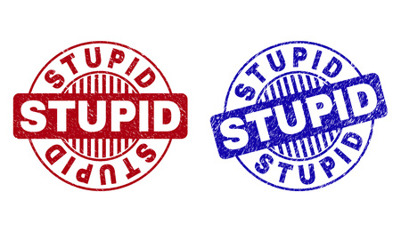 Grunge STUPID round stamp seals isolated on a white background. Round seals with distress texture in red and blue colors. Vector rubber overlay of STUPID label inside circle form with stripes.