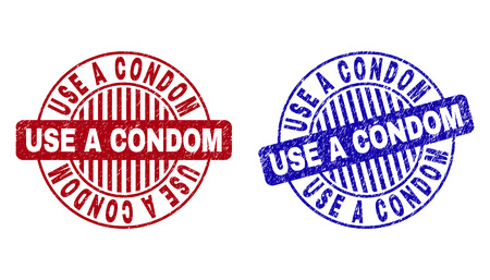 Grunge USE A CONDOM round stamp seals isolated on a white background. Round seals with grunge texture in red and blue colors.