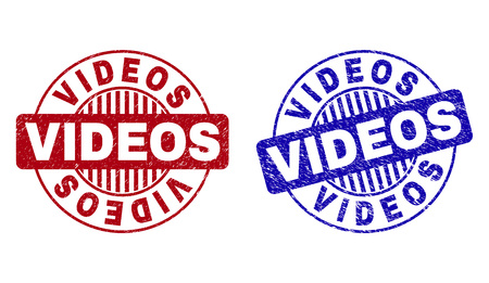 Grunge VIDEOS round stamp seals isolated on a white background. Round seals with grunge texture in red and blue colors. Vector rubber imitation of VIDEOS title inside circle form with stripes. Illusztráció