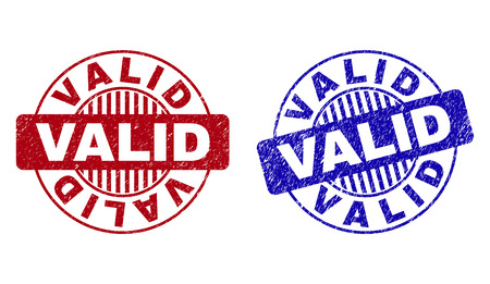 Grunge VALID round stamp seals isolated on a white background. Round seals with grunge texture in red and blue colors. Vector rubber watermark of VALID tag inside circle form with stripes.