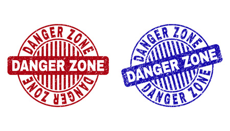 Grunge DANGER ZONE round stamp seals isolated on a white background. Round seals with grunge texture in red and blue colors. Vector rubber imitation of DANGER ZONE tag inside circle form with stripes.