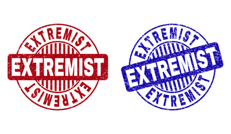 Grunge EXTREMIST round stamp seals isolated on a white background. Round seals with distress texture in red and blue colors. Vector rubber imprint of EXTREMIST title inside circle form with stripes.