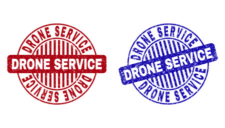 Grunge DRONE SERVICE round stamp seals isolated on a white background. Round seals with grunge texture in red and blue colors.