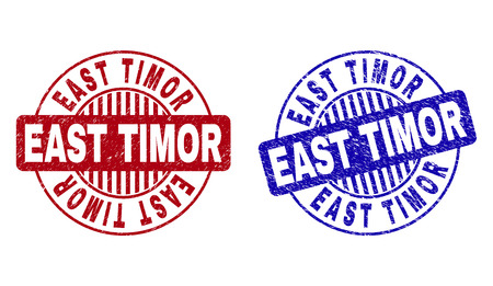 Grunge EAST TIMOR round stamp seals isolated on a white background. Round seals with grunge texture in red and blue colors. Vector rubber imitation of EAST TIMOR tag inside circle form with stripes.