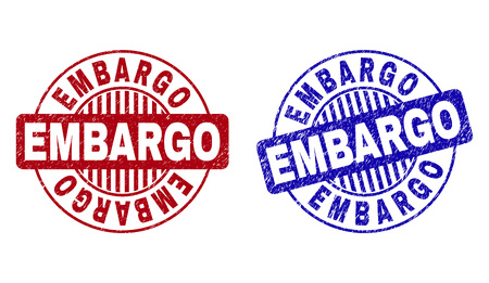 Grunge EMBARGO round stamp seals isolated on a white background. Round seals with grunge texture in red and blue colors. Vector rubber overlay of EMBARGO tag inside circle form with stripes. Illustration