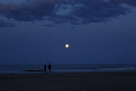 moonrising over beach