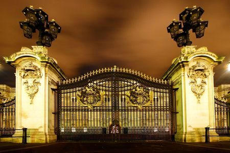 The maine gate of Buckingham Palace by night
