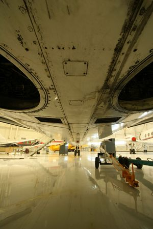 Under a passenger airliner