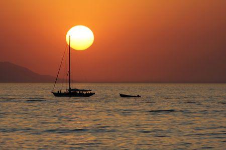 Sunset wit sailboat Stock Photo - 2606900