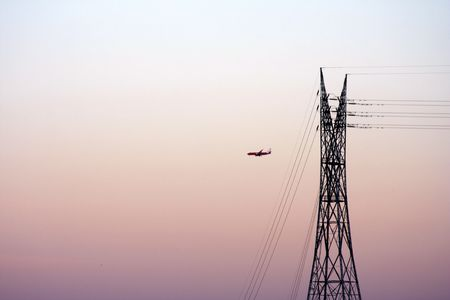 powerline: Electrical powerline with an aircraft Stock Photo