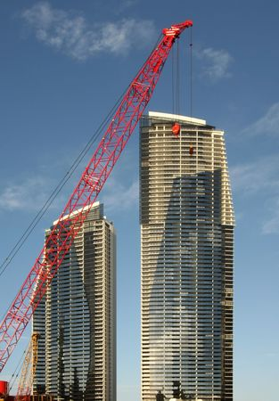 Red crane and towers Stock Photo