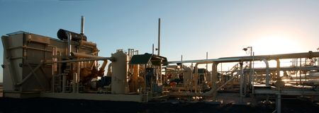 Naturalgas compressor satitions in early morning sunlight Stock Photo