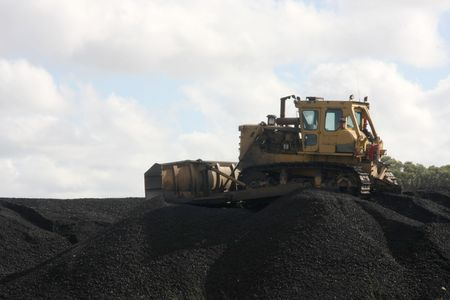 Bulldozer working on coal heap Stock Photo - 4354358