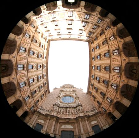 Sculptural group of Jesus and twelve apostles, ornate facade of famous cathedral in Montserrat in fish eye Stock Photo