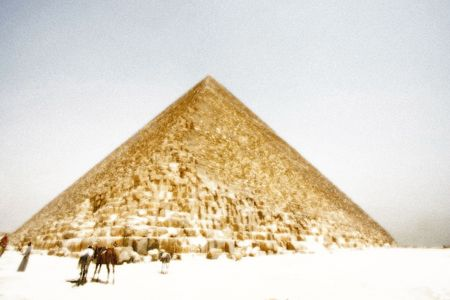 The great Pyramid  with local camel guide   Ilustration photo