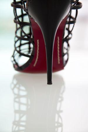 Modern fashion Black high heel, on reflective background Reklamní fotografie - 6413150
